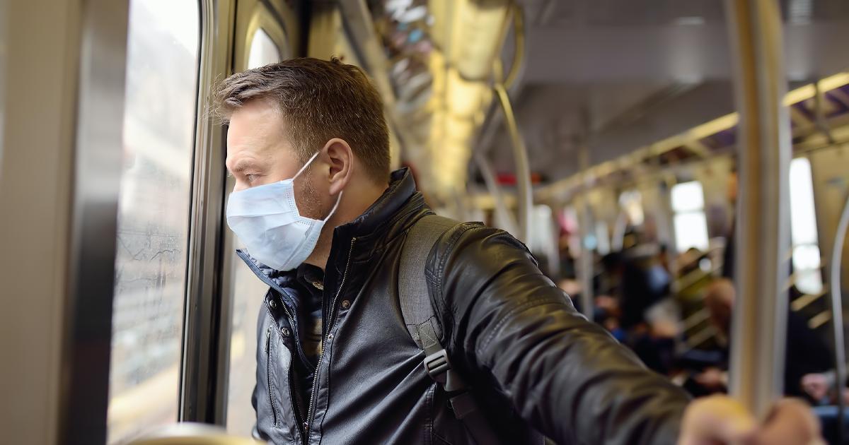 man wearing mask in luas train